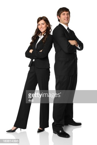 Business executives standing with arms crossed