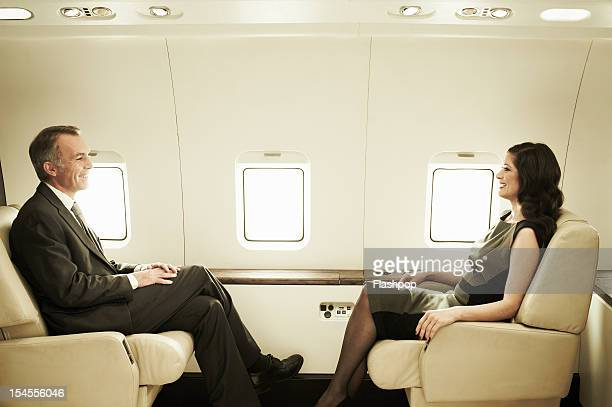 Business executives travelling on a private jet