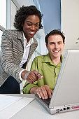 Business executives using a laptop