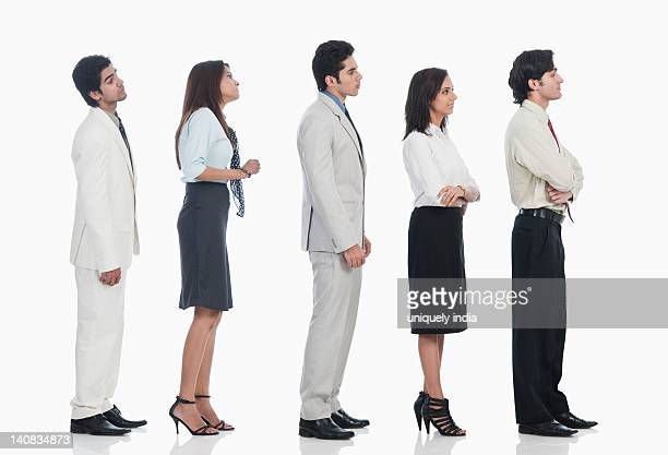 Business executives waiting in a line