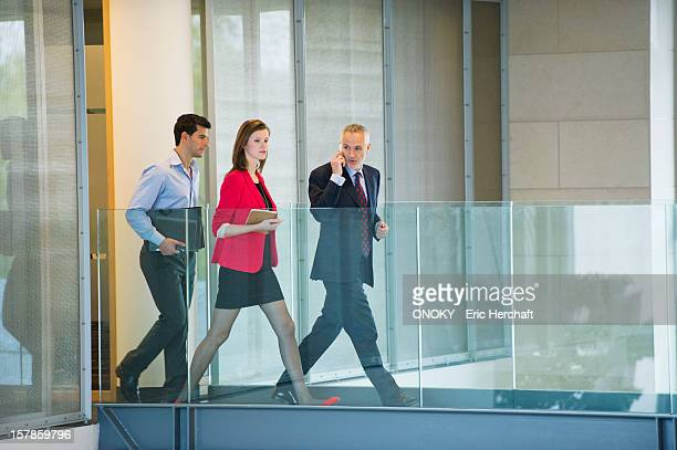Business executives walking in an office corridor