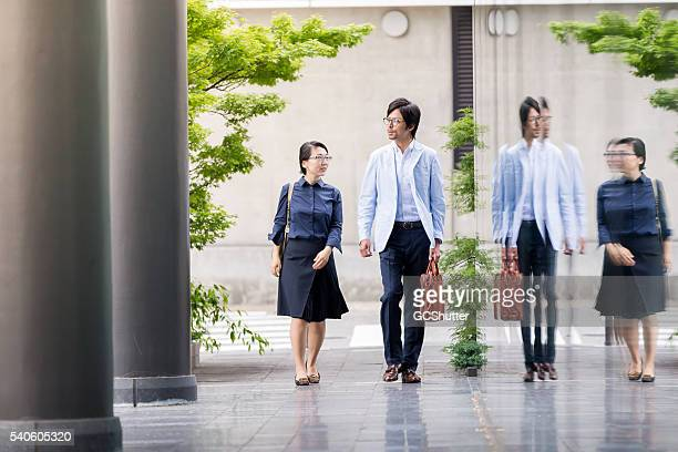 Business Executives Walking towards their office.