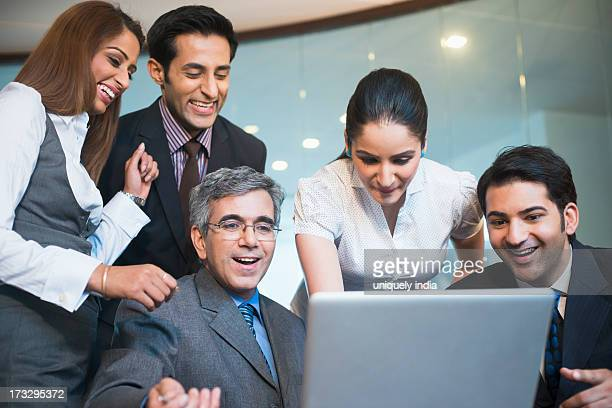 Business executives working on a laptop