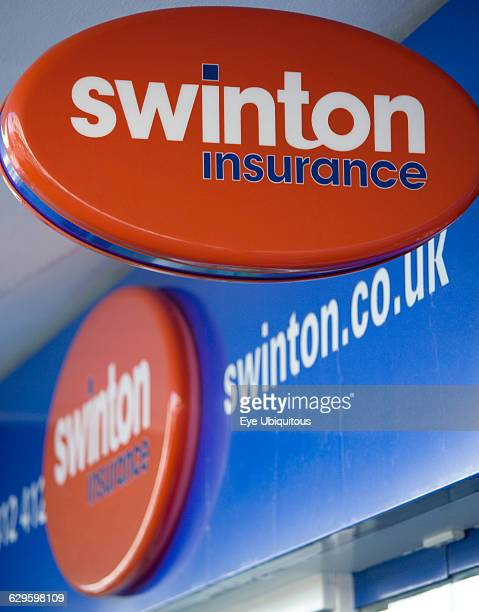 Business Finance Insurance Swinton Insurance sign and logo on a high street bank building