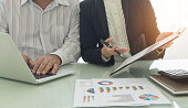 manager analyze financial numbers to view the performance of the company. business financial meeting concept.