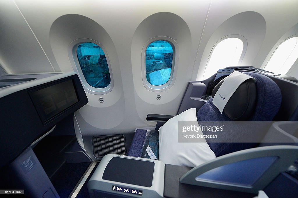 Business First class seating is seen with large dimmable windows with electrochromatic shades that are able to regulate their outside light with the touch of a button on the new Boeing 787 Dreamliner at Los Angeles International Airport on November 30, 2012 in Los Angeles, California. In January the new jet is scheduled to begin flying daily non-stop between Los Angeles International airport and Japan's Narita International Airport and later to Shanghai staring in March. The new Boeing 787 Dreamliner will accommodate 219 travelers with 36 seats in United Business First, 70 seats in Economy Plus and 113 in Economy Class. The carbon-fiber composite material that makes up more than 50 percent of the 787 makes the plane more fuel-efficient.