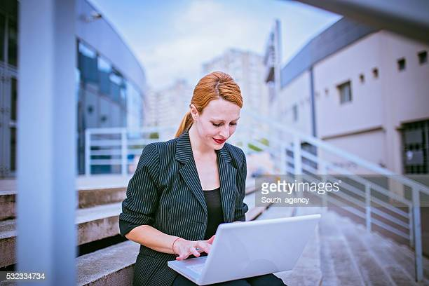 Business girl on laptop