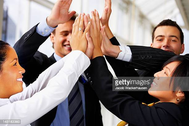 Business group doing the high five
