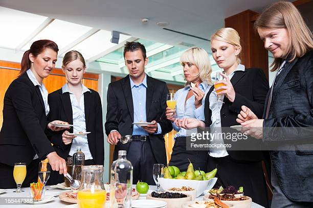 Business Group Having A Buffet Lunch