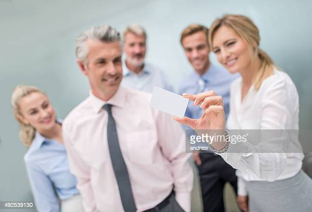 Business group holding a contact card