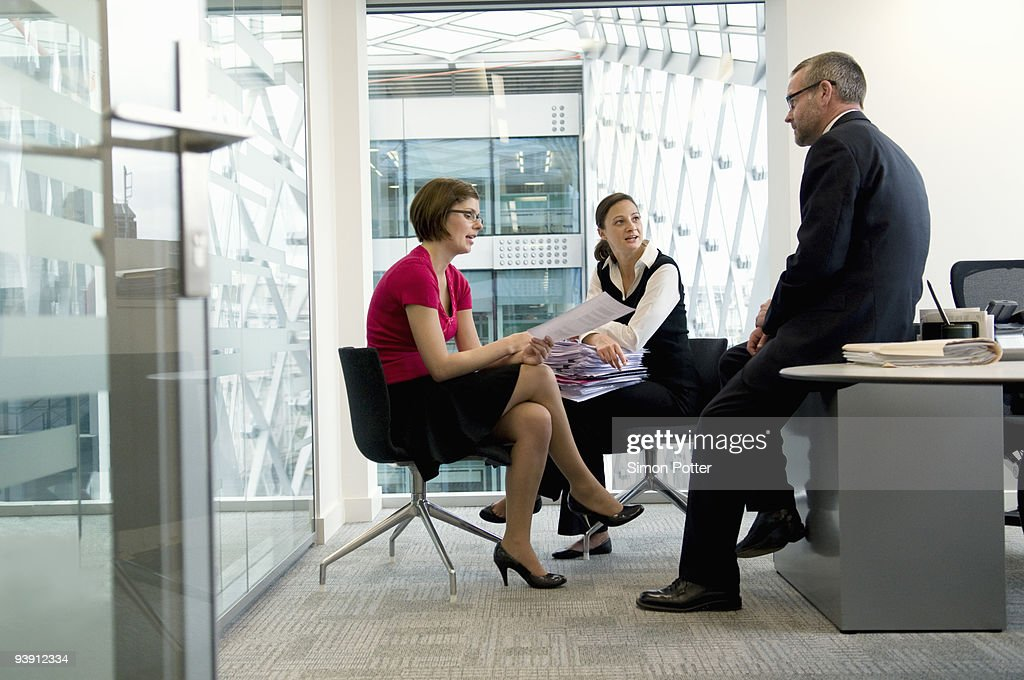 A business group in discussion. : Stock Photo