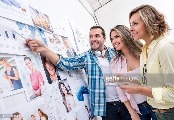 Business group working on a wall chart