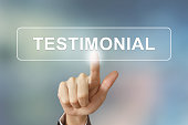 business hand pushing testimonial button on blurred background
