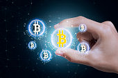 Business hand press offer bitcoin stock on tablet. concept investment finance digital technology.