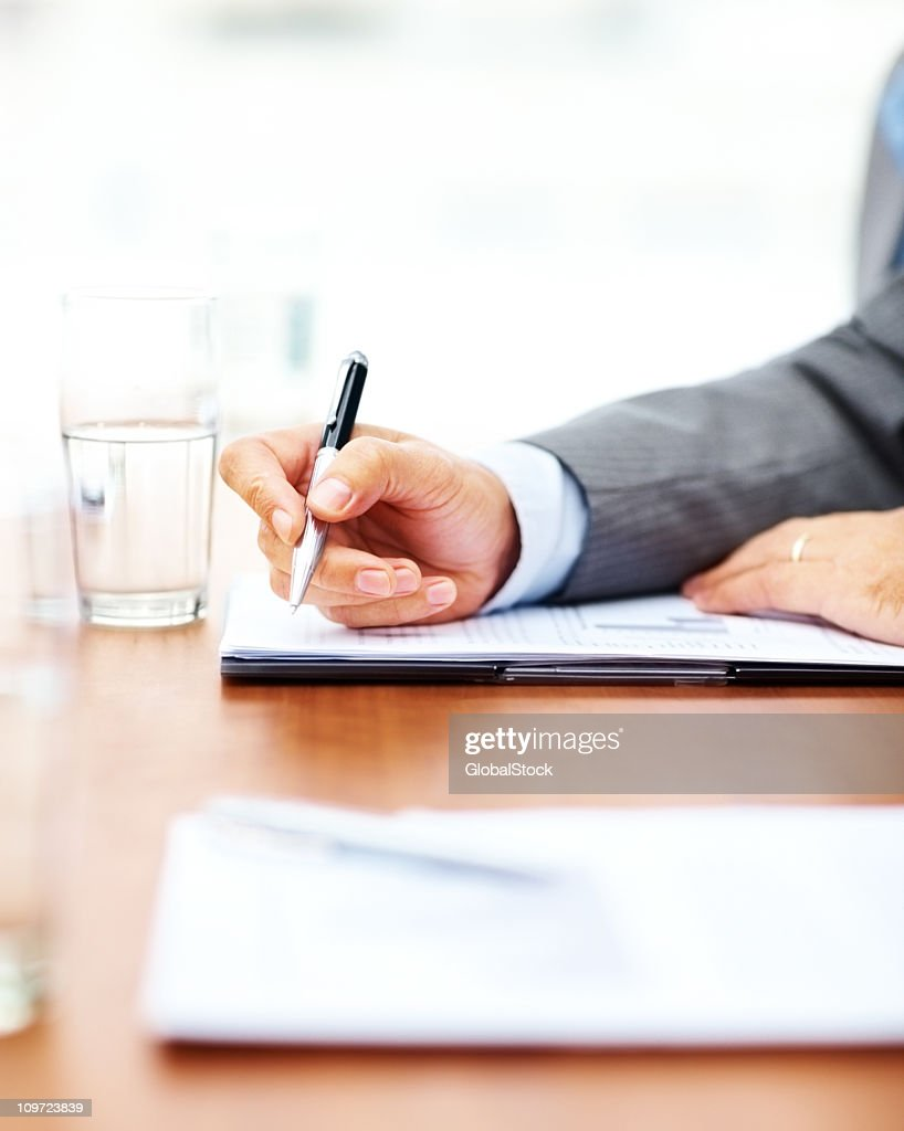 Business hand signing a document : Stock Photo