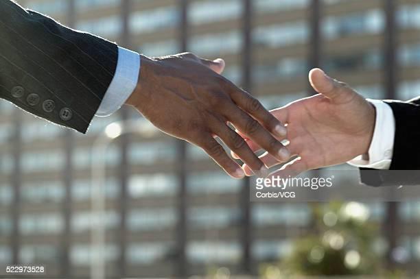 Business handshake, close up