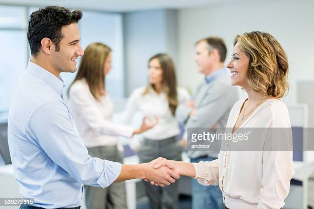 Business handshake closing a deal