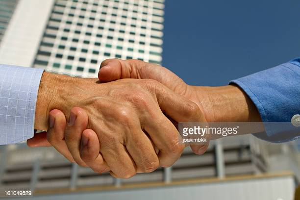 Business handshake in a financial district