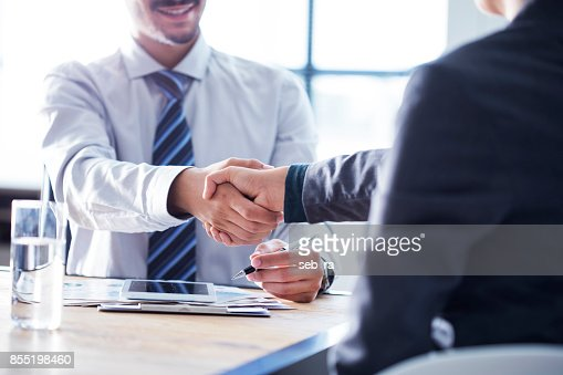 Business handshake in the office : Stock Photo