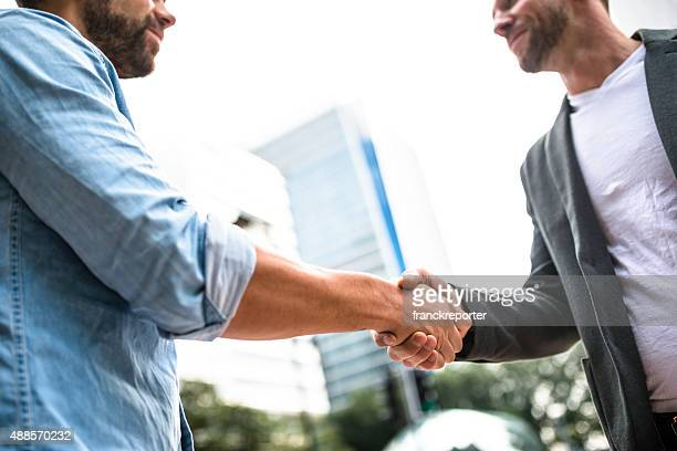 Business handshake on the financial district