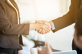 Business people joining hands together for dealBusiness people joining hands together for deal