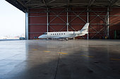 Business jet airplane is in hangar.