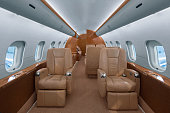 Business jet cabin with leather seats