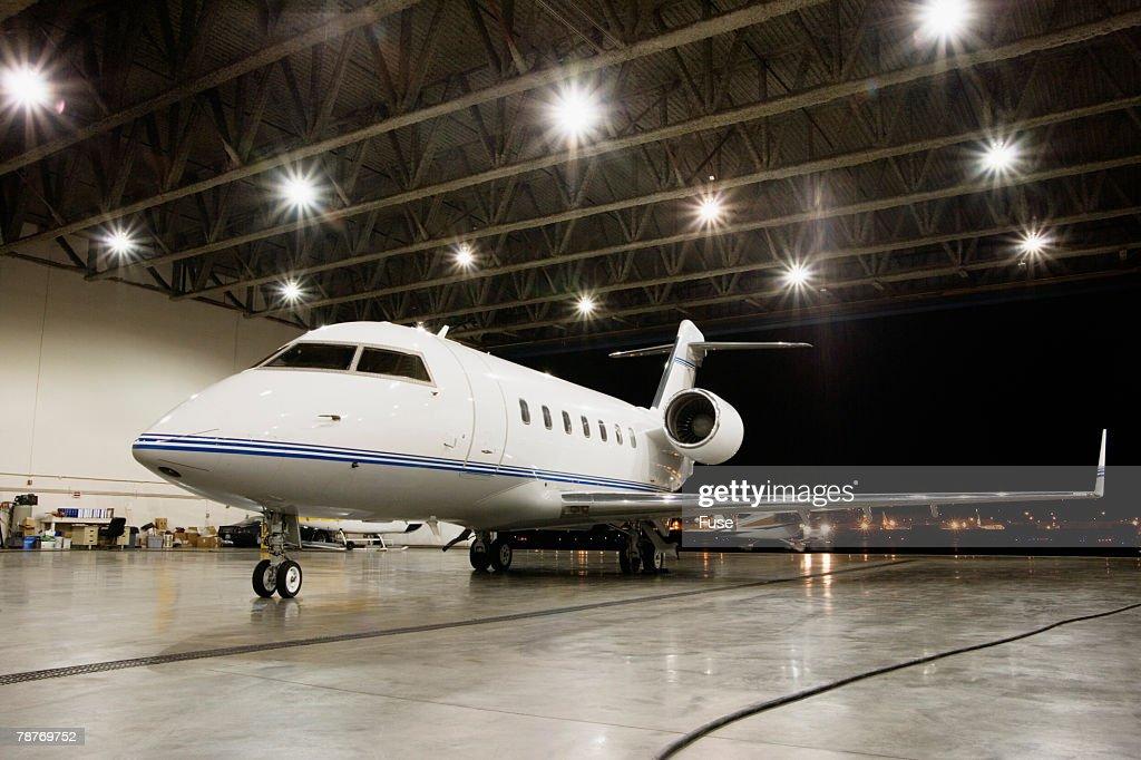 Business Jet Parked Inside Hangar