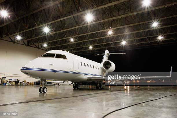 Business Jet Parked Inside Hangar