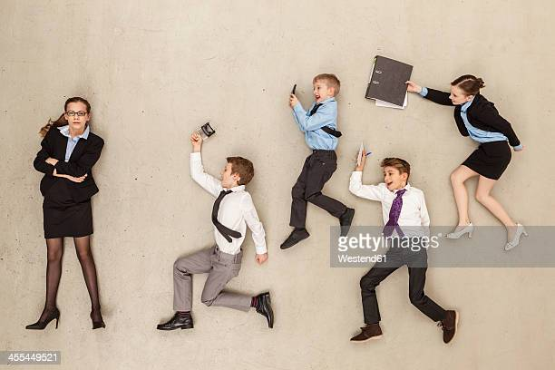 Business kids against beige background