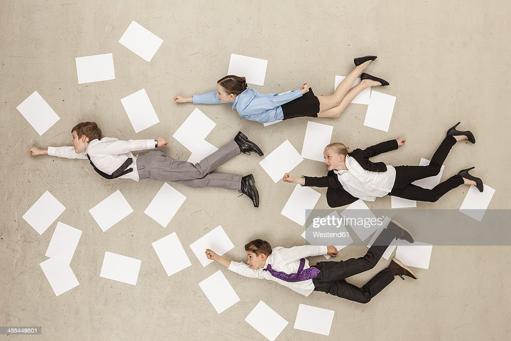 Business kids flying against beige background