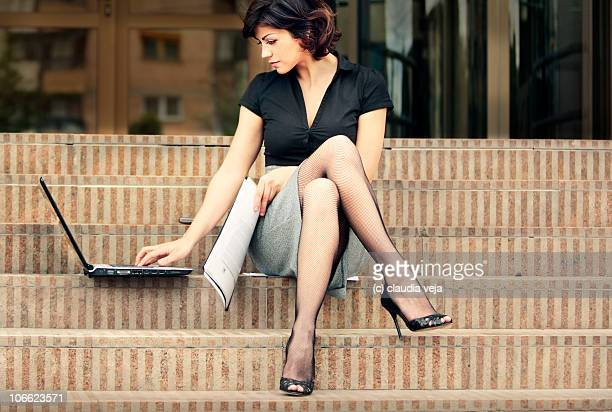 Business Lady with sexy legs outdoors