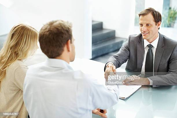 Business leader shaking hands with associate