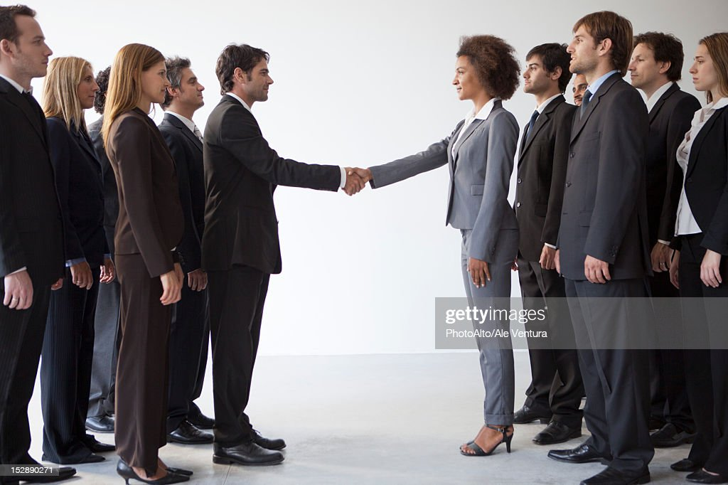 Business leaders shaking hands in agreeement