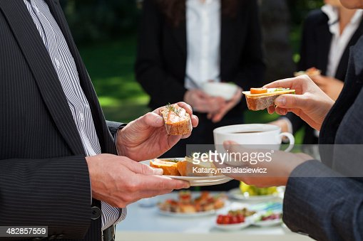 Business lunch in the garden : Stock Photo