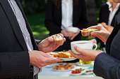 Business people who are eating lunch in the garden