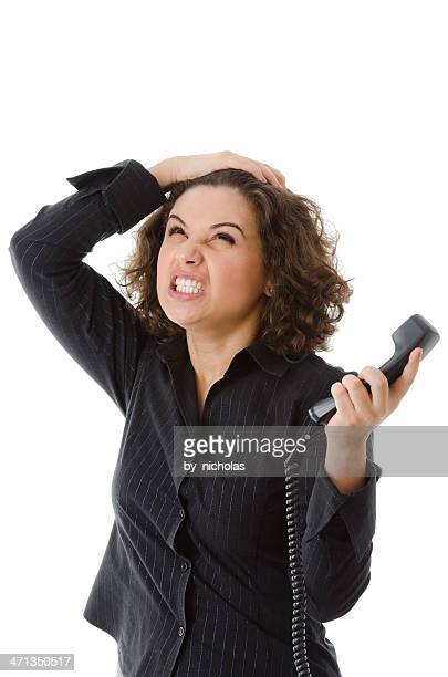 Business mad woman with phone in hand