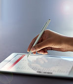 Shot of a businesswoman using a stylus on a digital tablet