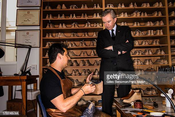 Business magnate and owner of LVMH Bernard Arnault is photographed at Berlutti's bespoke workshop for Paris Match on June 13 2013 in Paris France