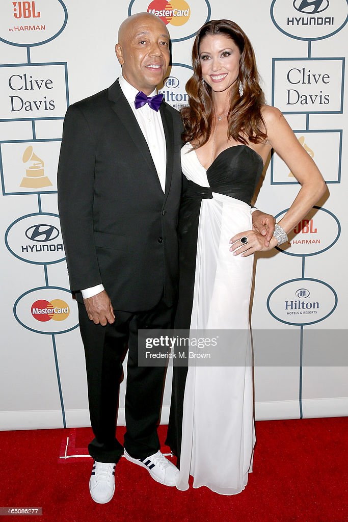 Business magnate Russell Simmons (L) and actress Shannon Elizabeth attend the 56th annual GRAMMY Awards Pre-GRAMMY Gala and Salute to Industry Icons honoring Lucian Grainge at The Beverly Hilton on January 25, 2014 in Beverly Hills, California.