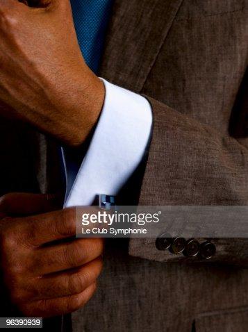 Business man adjusting cuff links