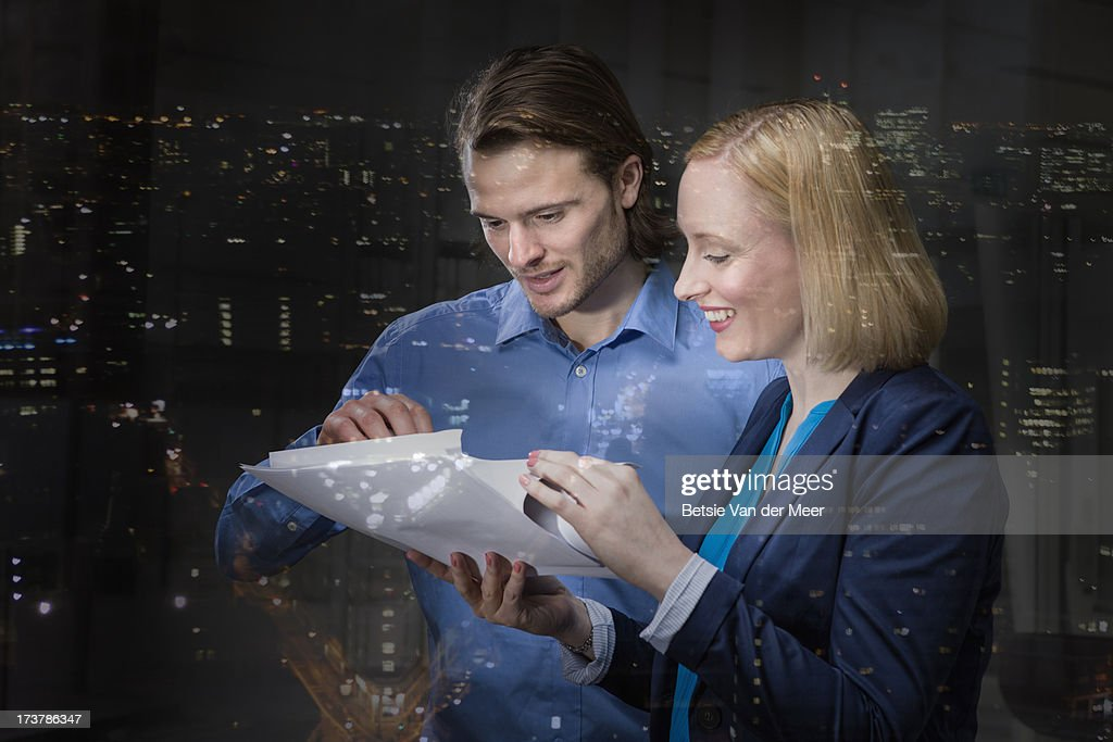 Business man and woman discussing work. : Stock Photo