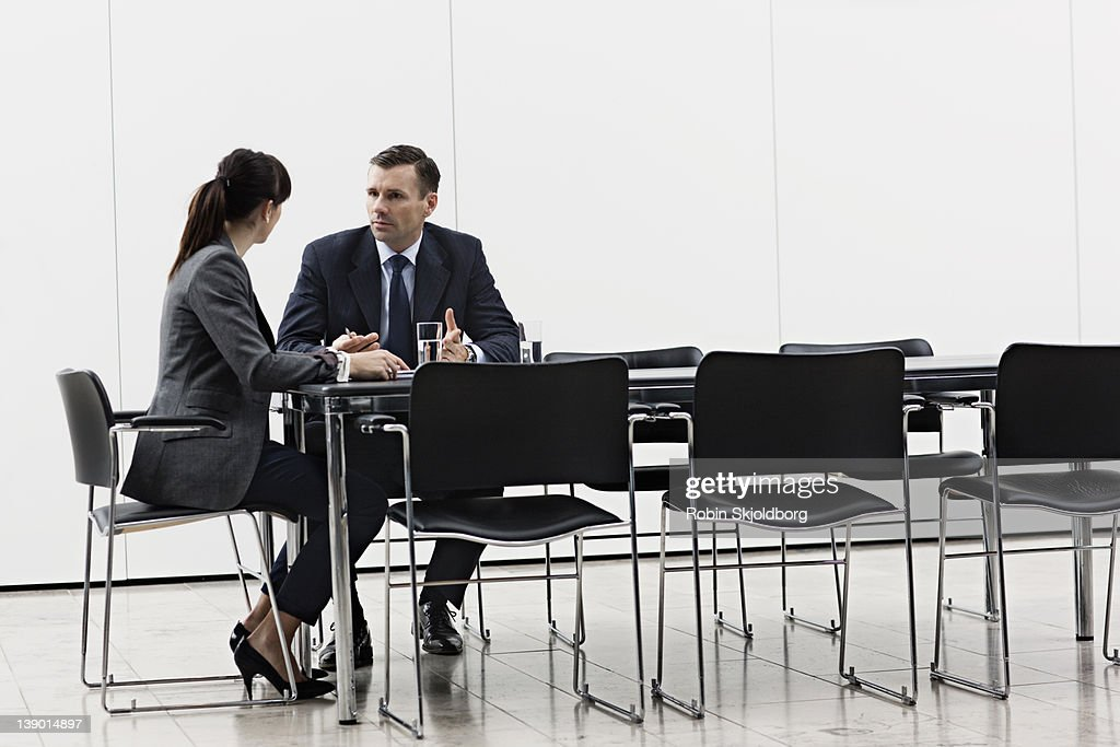 Business man and woman having a meeting : Stock Photo