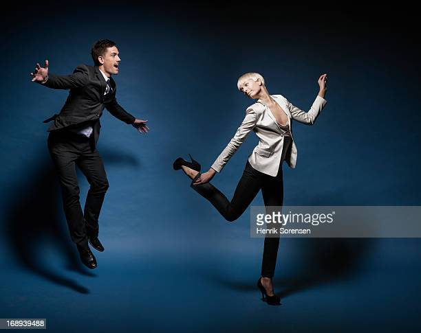 Business man and woman jumping