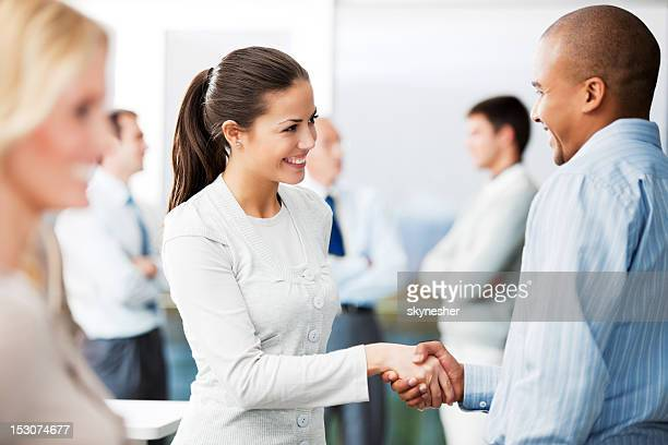 Business man and woman shaking hands.