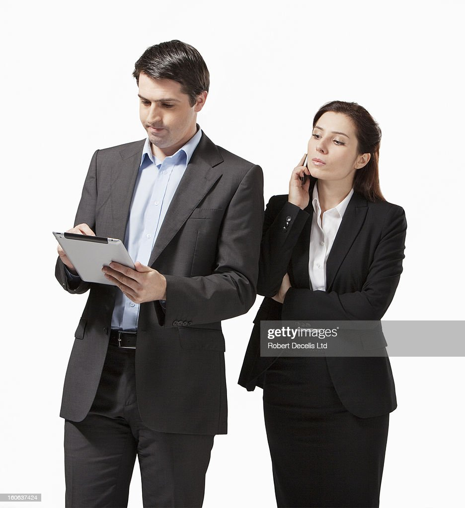 Business man and woman with tablet and phone : Foto de stock