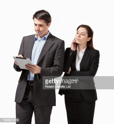 Business man and woman with tablet and phone : Foto stock