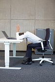 exercises in office. business man arms-back stretching on the table