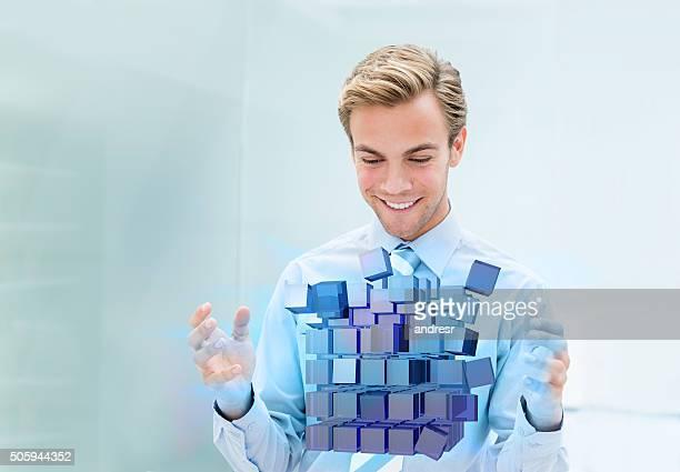 Business man assembling a 3D cube