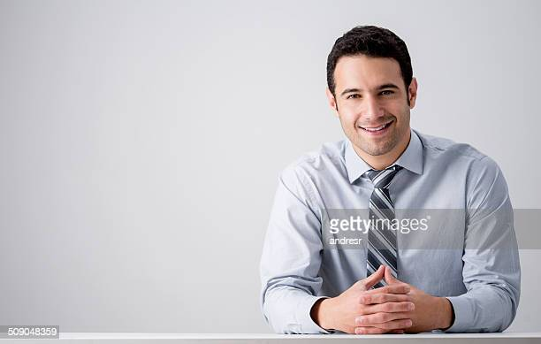 Business-Mann bei seinem Schreibtisch